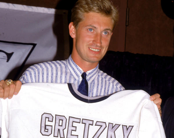 Wayne Gretzky shows off his new Kings uniform during a news conference after the trade.