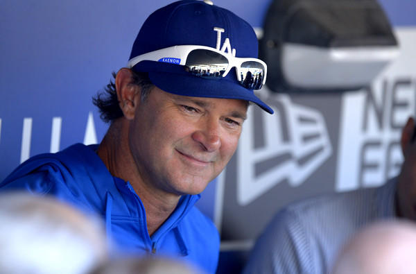 Dodgers Manager Don Mattingly talks to reporters before a game earlier this season.