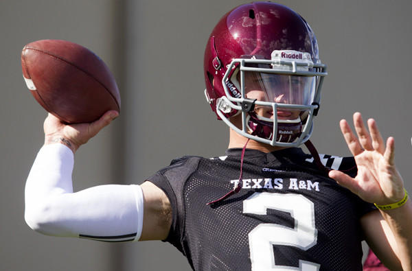 Texas A&M quarterback Johnny Manziel loosens up during practice on Monday.