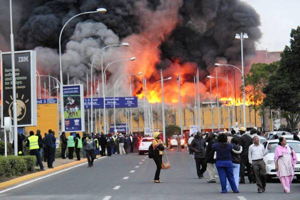 Smoke and flames billow from the arrival terminal at Jomo Kenyatta International Airport in Nairobi, Kenya.