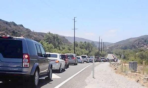 How will hundreds more cars seeking downtown parking mitigate this on Laguna Canyon Road?