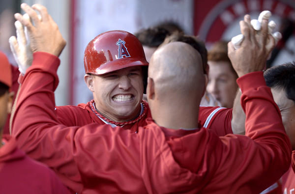 Angels outfielder Mike Trout is congratulated by teammates after hitting a solo home run against the Rangers in the first inning Tuesday night.