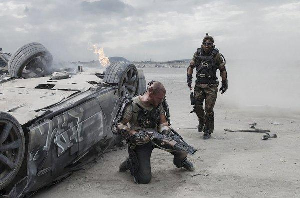 "Matt Damon and Sharlto Copley in ""Elysium."""