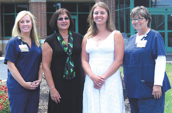 Laura Harmon, second from right, of Shippensburg, Pa., was presented the 2013 Kristin Runyon Memorial Scholarship by Barbara Runyon, second from left, the mother of the late Kristin Runyon. Joining Harmon and Runyon for the presentation were Chambersburg (Pa.) Hospital nurses and selection committee members, from left, Valerie Mongan and Teresa Napier.