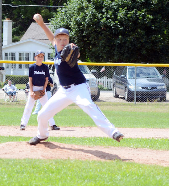 Petoskey 10U pitcher Jake Trudeau delivers a pitch during the Regatta Tournament in Harbor Springs last month. A pair of Petoskey 10U teams will play this weekend in the Sunset Showdown.