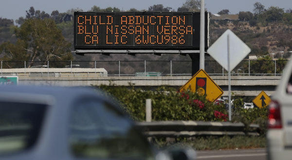 Drivers pass a display in San Diego showing an Amber Alert, asking motorists to be on the lookout for a vehicle.