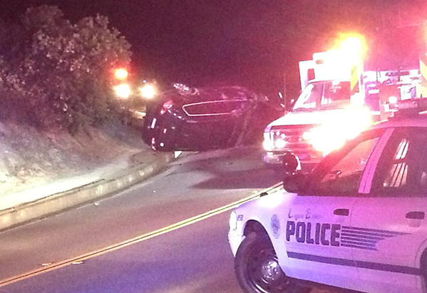 A Volkswagen Passat rests on its side after it hit a curb, causing the car to roll over late Monday night on Park Avenue in Laguna Beach, according to police. The driver, Ricardo Berge, 18, from Huntington Beach, was arrested on suspicion of felony driving under the influence.