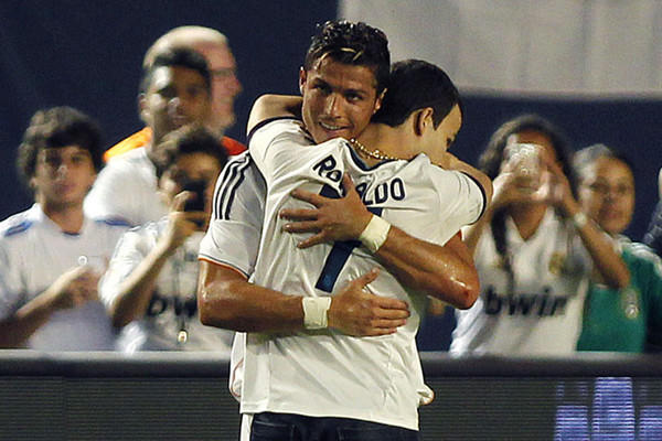 Fan hugs Real Madrid's superstar Christiano Ronaldo during the second half of play against Chelsea at Sun Life Stadium.