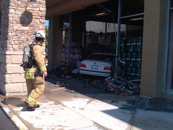 Firefighters extinguished a blaze that broke out after a BMW crashed through a glass wall at Binny's Beverage Depot in Highland Park.