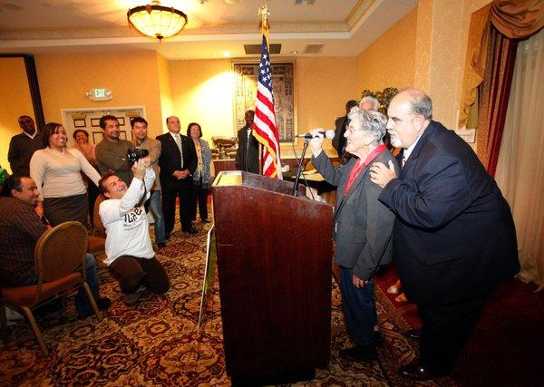 Hawthorne's Daniel Juarez, right, shown at an event in 2011 while he was still mayor-elect, faces new perjury charges.