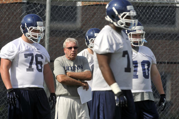 Storrs, CT 8/2/13 UConn associate head coach/offensive line coach George DeLeone watches as his players during their first open practice Friday afternoon in Storrs. Photo by JOHN WOIKE | woike@courant.com hc-uconn-football-practice-0803