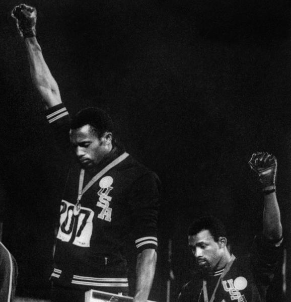 Sprinters Tommie Smith (L) and John Carlos in their black-gloved protest at the 1968 Olympics against U.S. racism.
