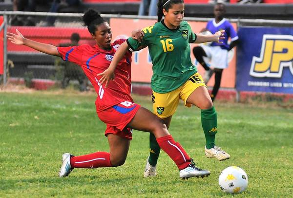 Montverde Academy girls soccer player Sarai Paul, left, and several teammates recently represented their homeland of Bermuda in an internatonal competition.