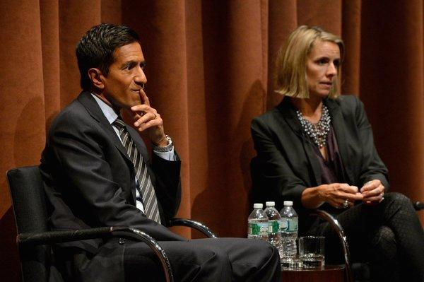 """Dr. Sanjay Gupta, here with """"Weed"""" collaborator Paige Figis, apologized this week for his previous stance against legalizing medical marijuana."""