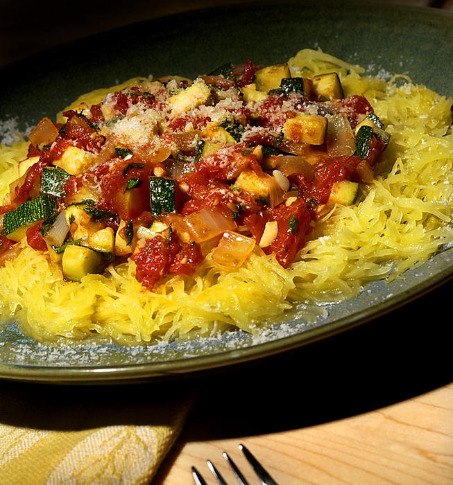 "Spaghetti squash ""pasta"" with a zucchini, garlic and tomato sauce"