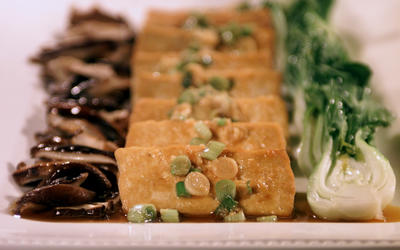 Tofu with shiitake mushrooms and baby bok choy