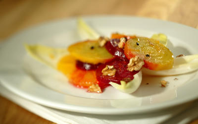 Red and golden beets with oranges, endive and walnuts