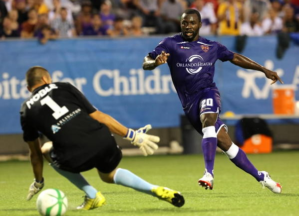 Orlando City player Jean Alexandre scores a goal in the first half of the Orlando City versus Harrisburg soccer game at the Florida Citrus Bowl on Saturday, July 20, 2013.
