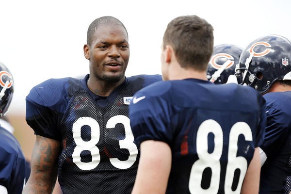 Bears tight end Martellus Bennett (83) talks with Bears tight end Kyle Adams during a pause in practice at training camp.