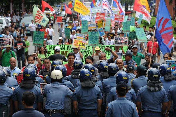 More than 20 years after U.S. bases in the Philippines were closed and the bulk of the foreign troops sent home, some Filipinos remain opposed to their return despite mounting concerns about China's might and the region's myriad territorial disputes. Riot police hold back protesters in this scene from Manila last month, when the government first floated the idea of revising the Visiting Forces Agreement to boost the U.S. presence.