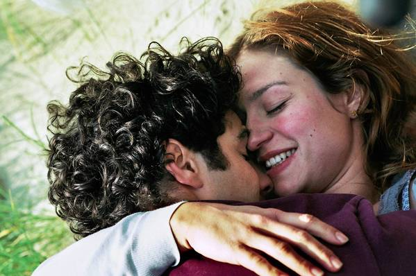"Tahar Rahim as Mounir and Emilie Dequenne as Murielle embrace in ""Our Children."""