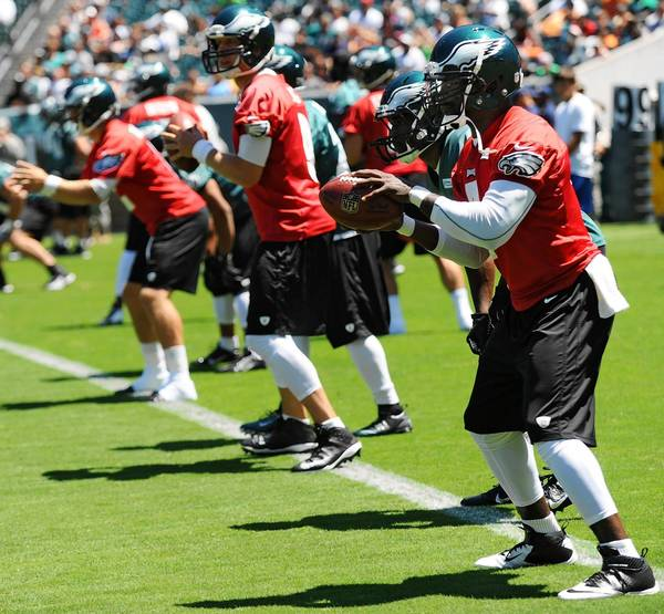 Quarterback Michael Vick (7) practices a snap and pass off. The Philadelphia Eagles held their second open Training Camp practice at Lincoln Financial Field Monday afternoon.