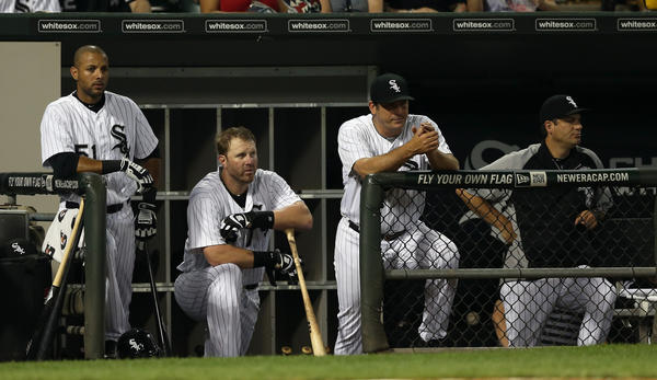 White Sox' Alex Rios, Adam Dunn, hitting coach Jeff Manto and manager Robin Ventura during a game against the Cubs.