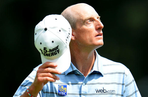 Jim Furyk's early round of 65 held up for a share of the lead with Adam Scott on Thursday during the first round of the PGA Championship at Oak Hill Country Club in Rochester, N.Y.