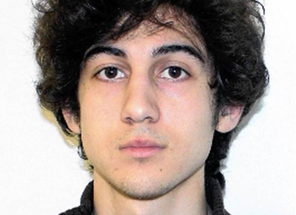 "Boston Marathon bombing suspect Dzhokhar Tsarnaev allegedly texted a friend after the attack, asking him to go to his dorm room and ""take what's there."" Two students were indicted in the case Thursday."