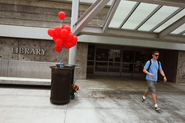 Red balloons and flowers serve as a memorial in June to the students who lost their lives in the shooting rampage at the library of Santa Monica Community College.