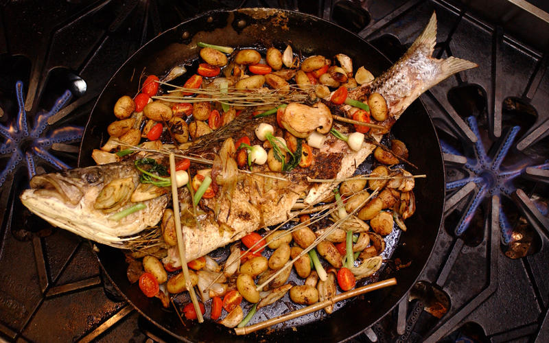 Whole baked fish with roasted vegetables