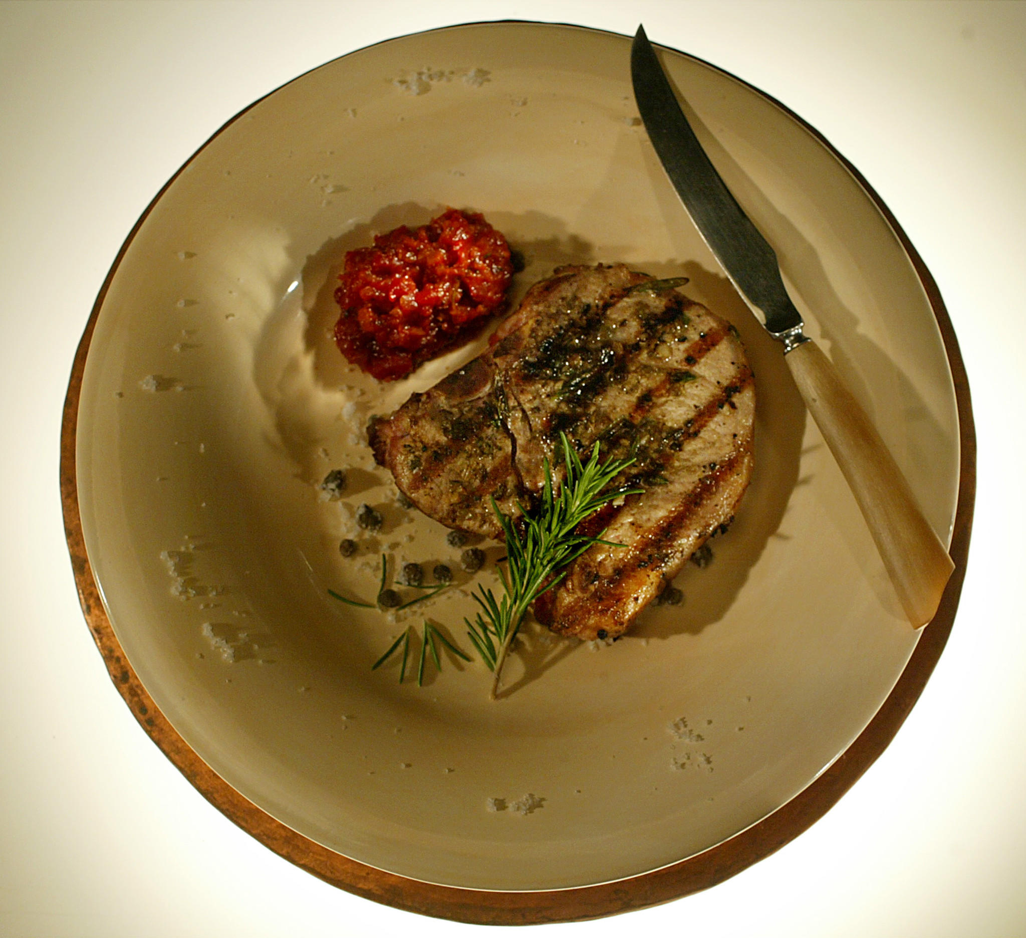 Recipe: Garlic-caper grilled pork chops with Sicilian sauce ...