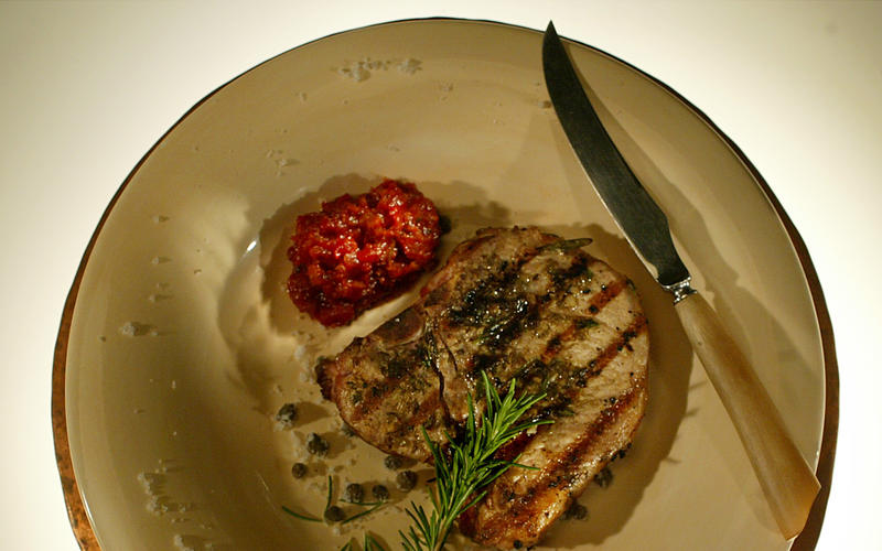 Garlic-caper grilled pork chops with Sicilian sauce