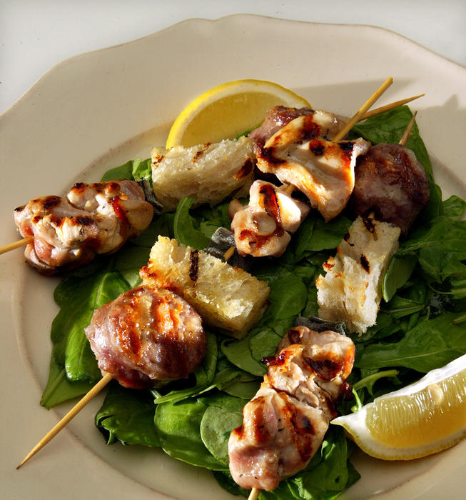Sausage, chicken and bread skewers