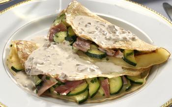 Crespelles with prosciutto and zucchini