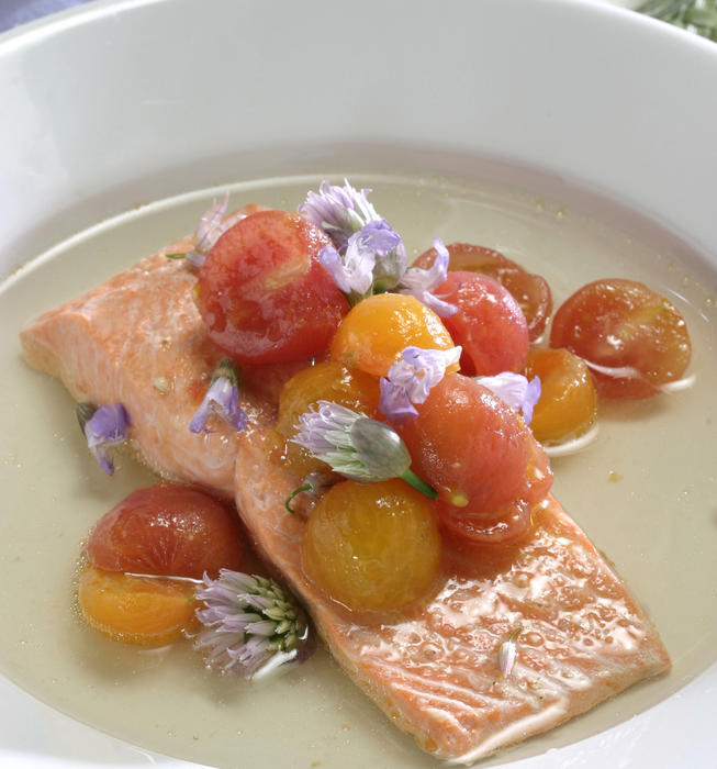 Wild salmon steamed with cherry tomatoes and sage flower-tomato consomme