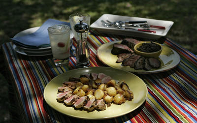 Brined pork tenderloin with `Tuscan home fries'