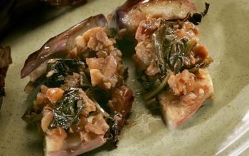 Eggplant stuffed with kale and walnuts
