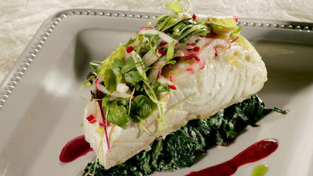 Slow-poached sturgeon with celery and radish salad, roasted beets and creamed spinach