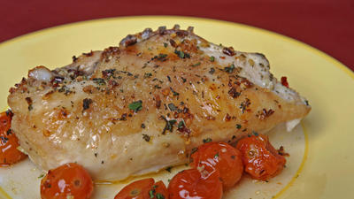 Spicy roast chicken with tomatoes and marjoram