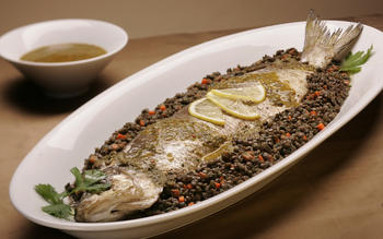 Roasted whole whitefish with charmoula and French green lentils