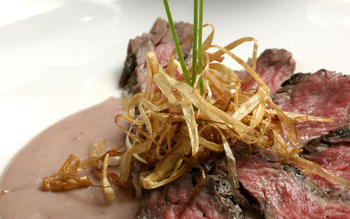 Grilled skirt steak with crispy leeks and beurre rouge