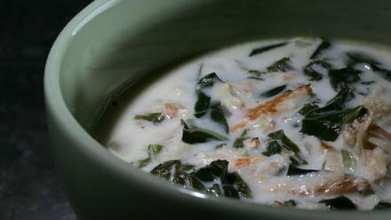 Crab and greens soup with coconut milk