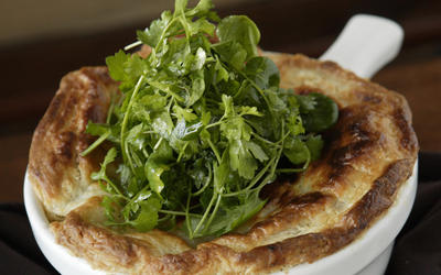 Winter root vegetable pot pie with spicy cress salad