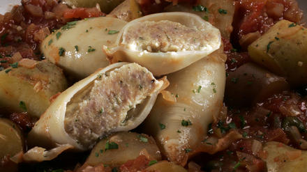 Sausage-stuffed squid braised with tomatoes and potatoes