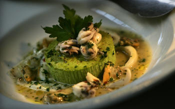 Pea budino with squid and clam ragu