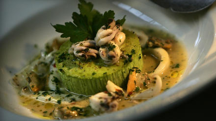 Pea budino with squid and clam ragu