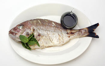Grilled fish with basil oil