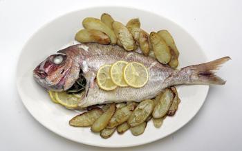 Roast fish stuffed with lemon and rosemary