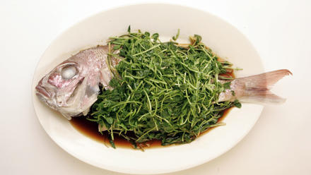 Steamed fish with pea shoots
